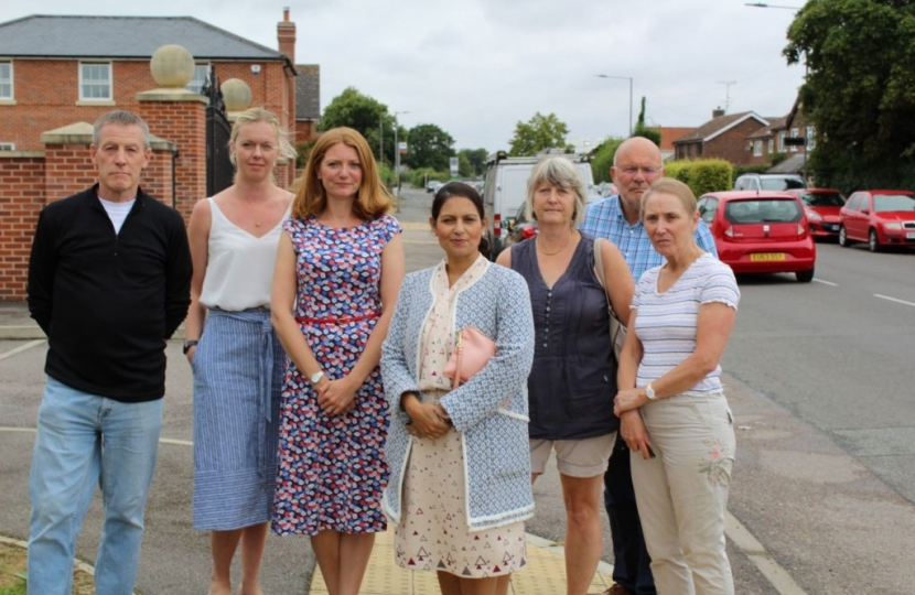 Priti Patel MP (front) with concerned local residents in Copford assessing the nuisance car parking problem. Cllr Janet Maclean, CBC Ward Councillor and Cllr Graham Barney, Chairman of Copford with Easthorpe Parish Council are in the back row, right.